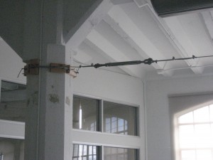 Cable Attached to Column with Wood Blocks